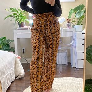 ORANGE SNAKE PRINT FLARED TROUSERS